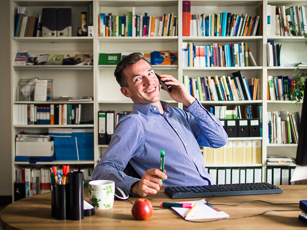 A motivated staff member at his desk